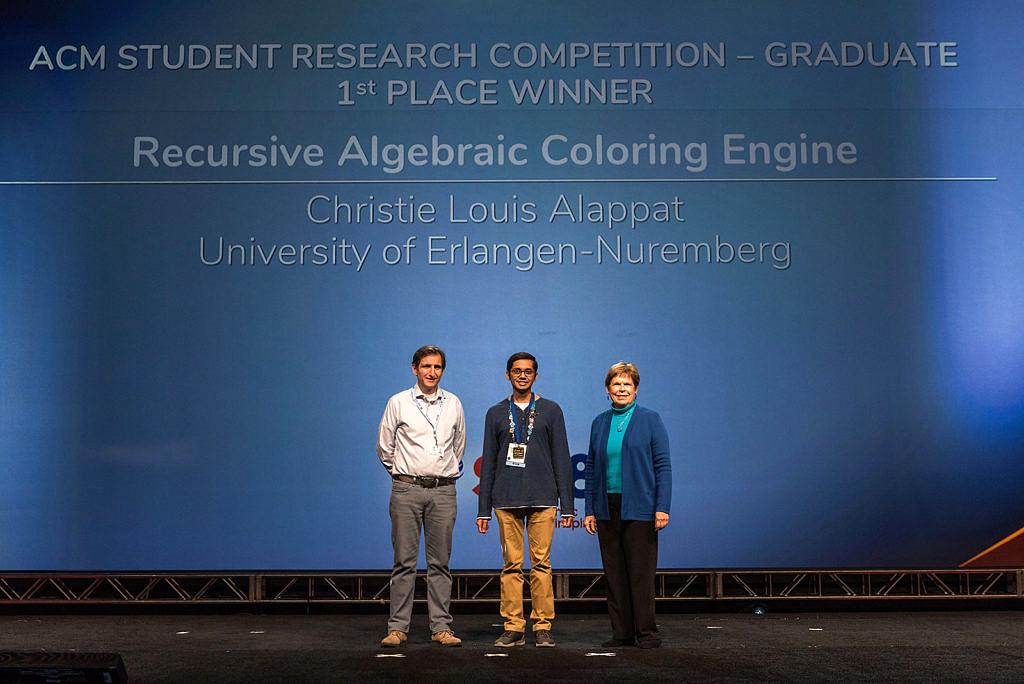 C. Alappat (Mitte) bei der Preisverleihung im November 2018 in Dallas